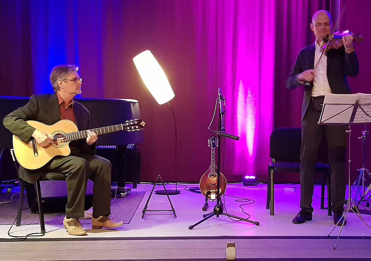 Rick Hannah plays acoustic jazz guitar on Alhambra with Ulli Bartel on violin and mandolin
